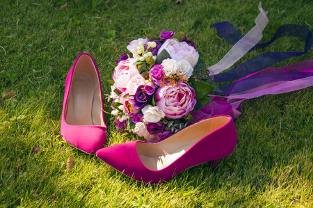 part of me: A wedding bouquet with the brides pink shoes on the grass