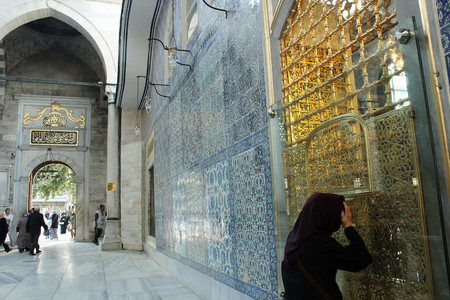 look inside: Istanbul, Turkey - September 21, 2015: Muslim woman to look inside from the window of The tomb of Eyp Sultan