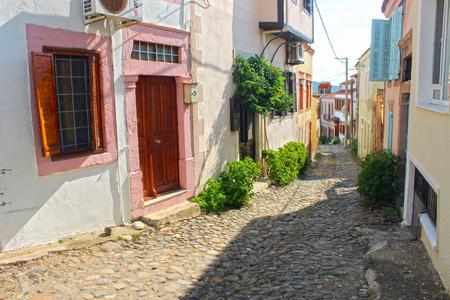 consequence: Touristic narrow street of the old town, C Alibeyler Island, Ayvalik. It is a small island in the northwestern Aegean Sea, off the coast of Ayvalik in Balikesir Turkey.