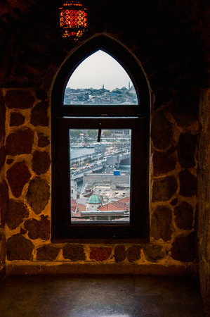 window view: Window in view of golden horn Galata Tower in Istanbul.