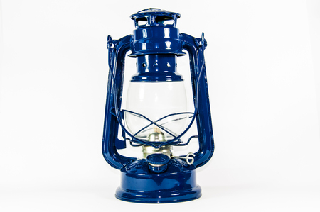 hurricane lamp: An old blue oil lamp isolated on white