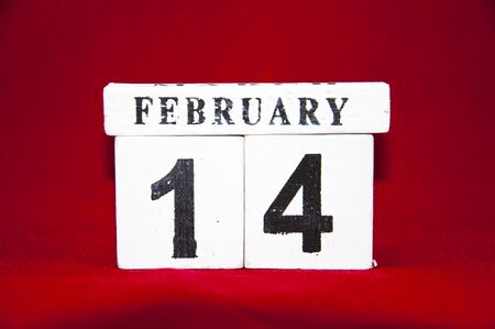 background red: 14. February - One a wooden calender Valentines day Foto de archivo