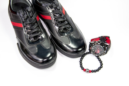 red stripe: Black men shoes with red stripe, watch and bracelet isolated by white background