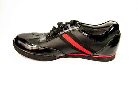 red stripe: Black men shoes with red stripe isolated with white background