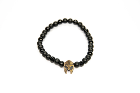 lux: Spartan figure with black beads men bracelet isolated on white background