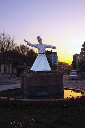 soul searching: Istanbul, Turkey - April 10, 2016: Dervish statue on the city sunset in Kutahya, Turkey