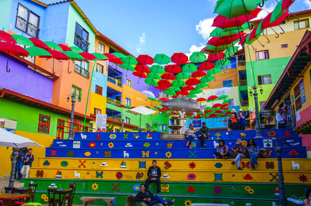 Guatape, COLOMBIA - DECEMBER 14, 2016: Colorful city streets and decorated houses of Guatape near Medellin, Antioquia, Colombia