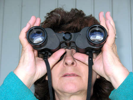 Woman looking through binoculars photo