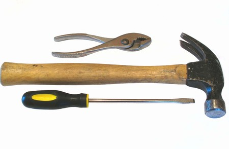 hammer pliers and screwdriver photo on white