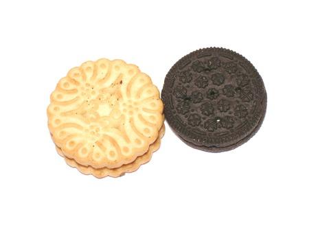 Chocolate and vanilla cookies photo on white