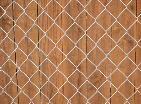 Horizontal photo of wood and chain link fence background