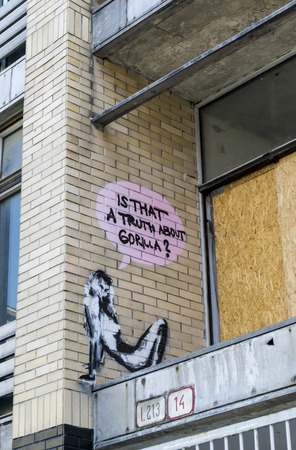 boarded: Graffiti slogan is that a truth about gorilla next to boarded up window Editorial