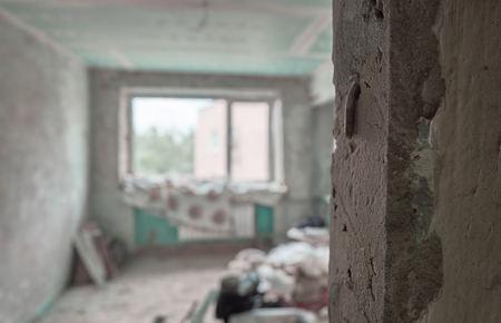 Major overhaul preparing. Empty apartment with broken wall
