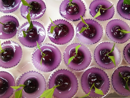 plating: Thai Sweet Bean Confections plating in Purple Coconut Sweet Pudding Jelly Thai Dessert of Kanom Look Choup nai Wun Kati