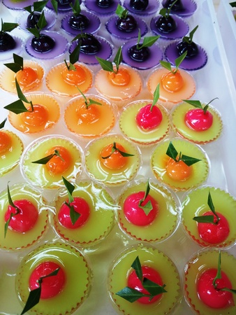 confections: Colorful of Thai Sweet Bean Confections plating in Coconut Sweet Pudding Jelly (Thai Dessert of Kanom Look Choup nai Wun Kati)