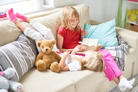 Little Girls Reading Fairytales at Home