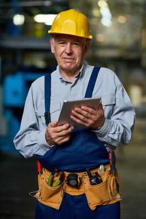 Senior Worker Posing with Digital Tablet