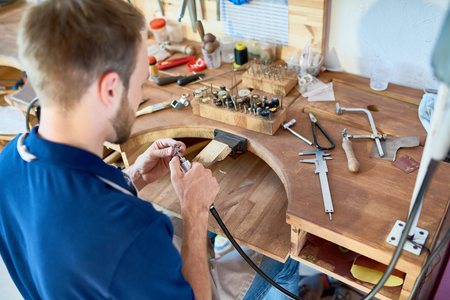 Jeweler Working at Table