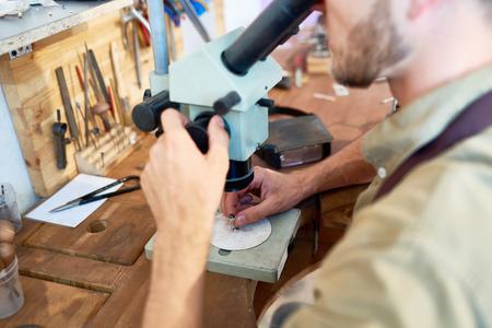 Jeweler Examining Ring Stock Photo