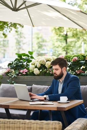 Modern Businessman Working with Laptop Outdoors