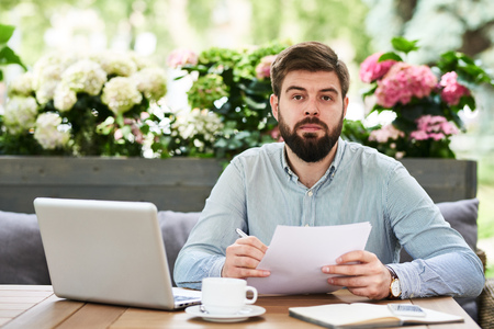 Bearded Entrepreneur Working in Outdoor Cafe