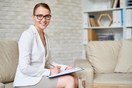 Beautiful Psychiatrist Posing in Office