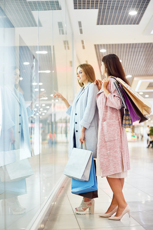 Girls Window Shopping in Mall Stock Photo