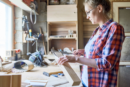 Female Carpenter Working with Wood