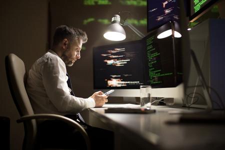 Talented Programmer Working Late Banco de Imagens