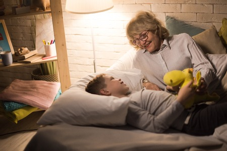 Grandmother Telling Stories to Little Boy