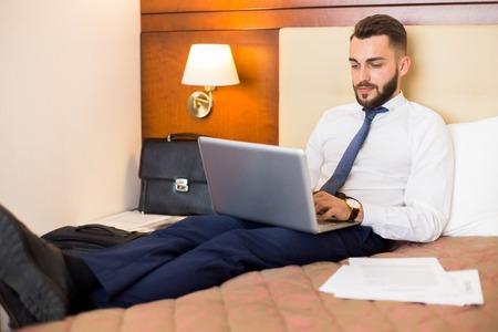 Handsome Businessman Working in Bedroom 스톡 콘텐츠