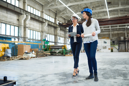 Female engineer holding factory tour for investor Stok Fotoğraf