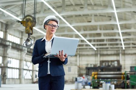 Successful building contractor using laptop