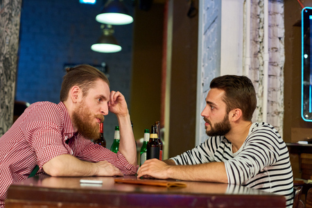 Two Buddies Talking in Bar Stock Photo