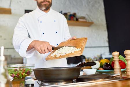 Caramelizing Onion in Restaurant Kitchen