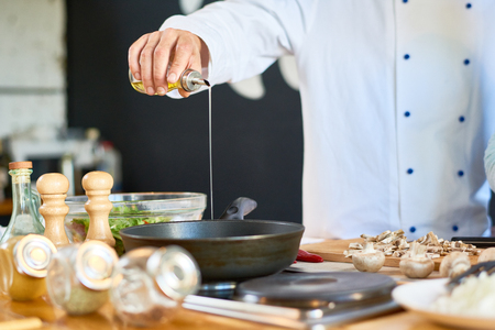 Unrecognizable Chef Frying Mushrooms