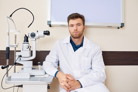 Professional Ophthalmologist Posing with Slit Lamp