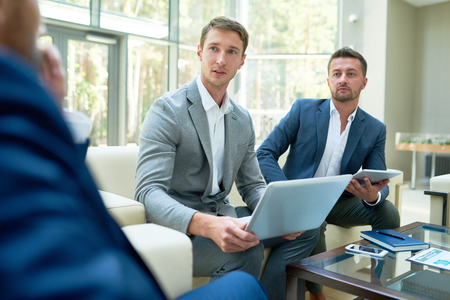Two Entrepreneurs Pitching Business Project Stock Photo