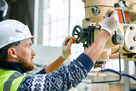 Factory Worker Using Machine Units Standard-Bild