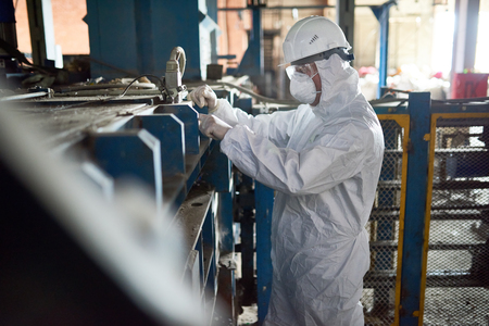 Worker in Hazmat Suits at Modern Factory Reklamní fotografie