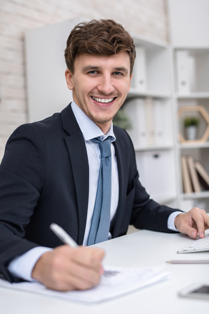 Successful Entrepreneur Posing at Workplace