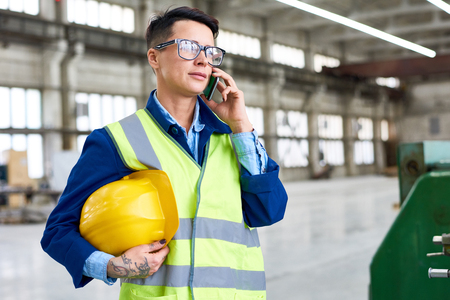 Confident Technician Using Smartphone