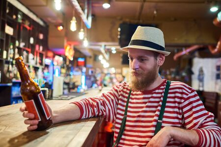 Bearded Young Man Chilling in Pub Stock Photo