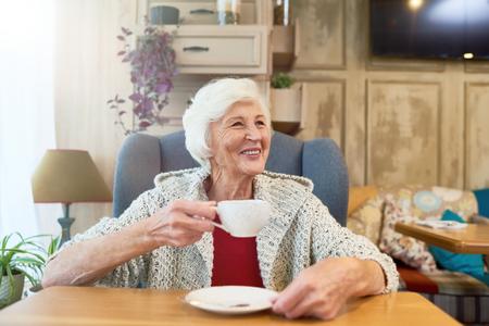 Happy Senior Lady Enjoying Tea