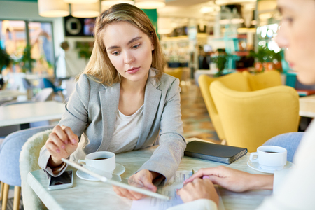 Young Woman in Business Meeting Stock Photo
