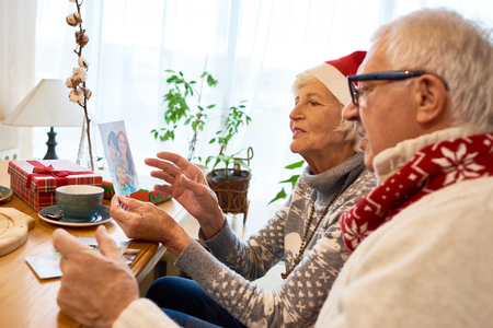 Senior Couple Looking at Photos  on Christmas