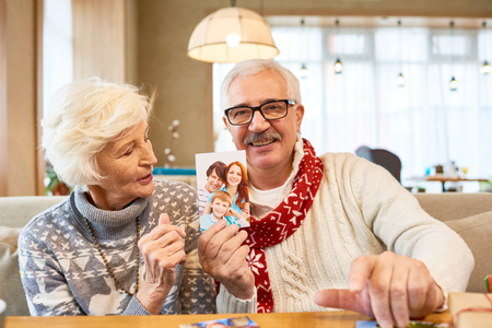 Senior Couple Remembering  Family on Christmas