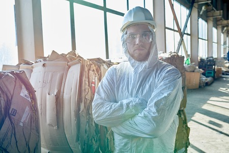 Worker Posing in Sunlight at Modern Waste Processing Plant