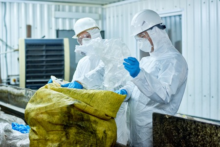 Workers Sorting Plastic on Trash Recycling Plant
