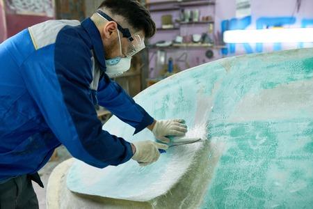 Man Doing Boat Repairs